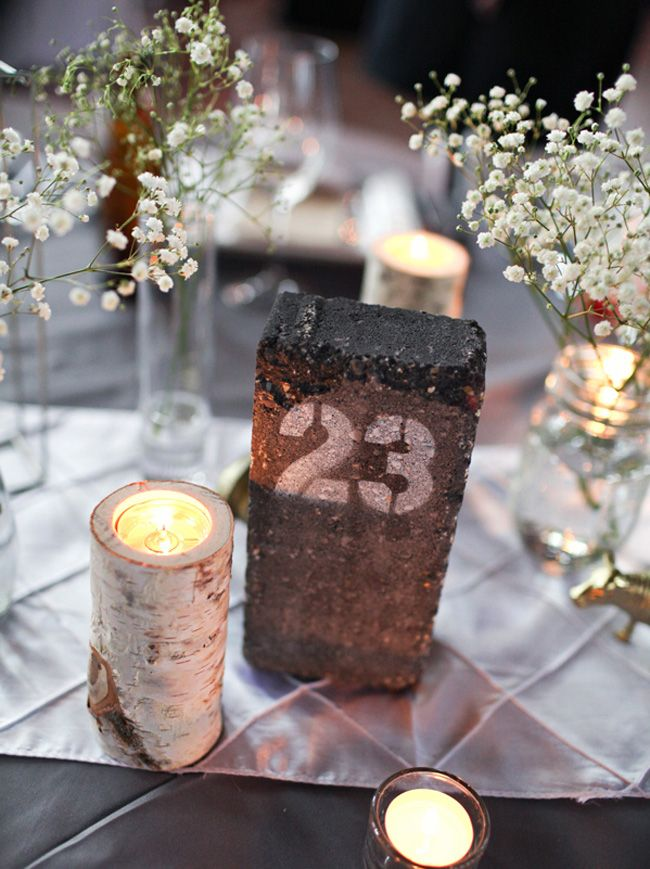 Industrial Chic Wedding Table Numbers: Brick | SouthBound Bride | http://www.southboundbride.com/industrial-chic-wedding-table-numbers | Credit:  The Rasers/The Enchanted Florist via Junebug Weddings