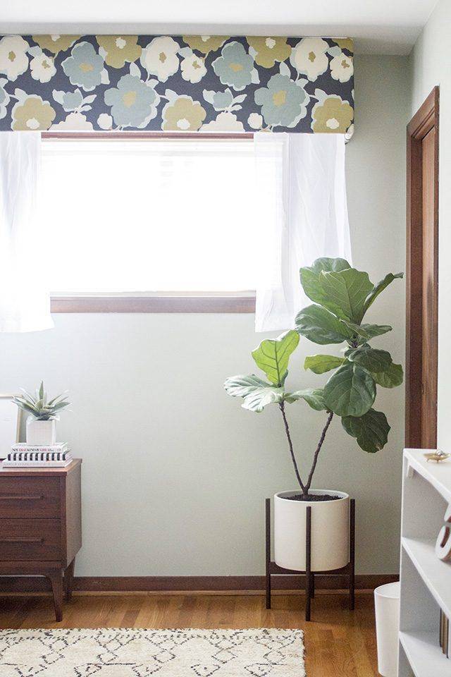 Find out how to cover up that unsightly AC wall unit of yours with a DIY fabric-wrapped cornice board.