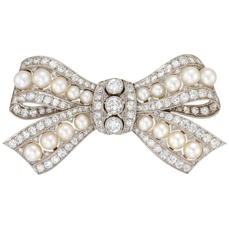 Edwardian Pearl and Diamond Bow Brooch | From a unique collection of vintage brooches at http://www.1stdibs.com/jewelry/brooches/brooches/