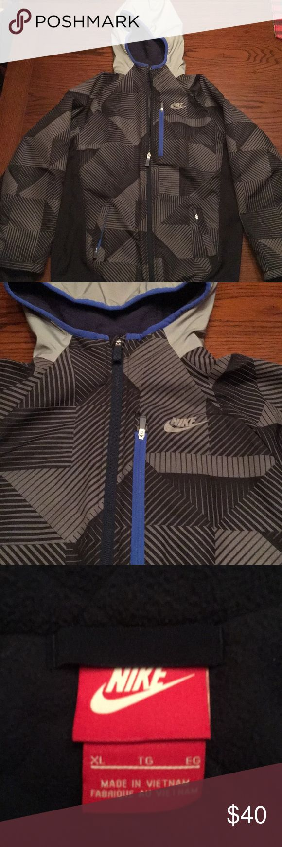 Nike boys winter jacket Nike winter jacket: light weight but warm, fleece interior, zip front with hood, 2 front hand pockets and a chest pocket, also inner pocket, sleeves have warm wrist sleeves with thumb holes.  EUC Nike Jackets & Coats