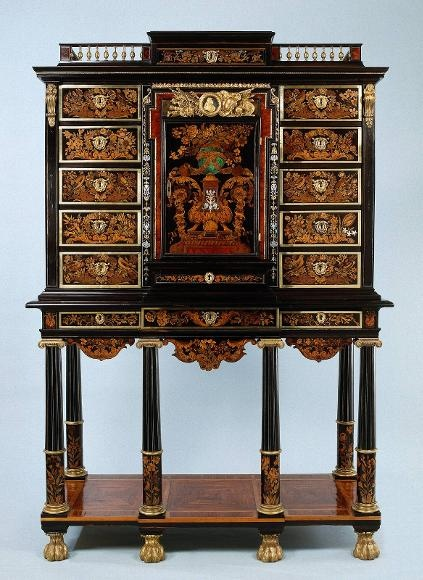 Andre-Charles Boulle  The Highboy  is consists of two parts:a chest of drawers(furniture frame that contains drawers) and a legged stand beneath it. The stand usually has one to three drawers and a shaped apron. The entire piece was usually crowned by cornice moilding or a pediment(triangular, decorative top). A broken pediment is one in which the middle is open for an ornament to rise from the center of the hood.