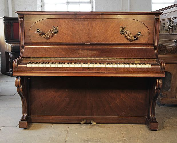 A 1924, Gaveau upright piano with a sunburst, rosewood case and Art Nouveau styling at Besbrode Pianos