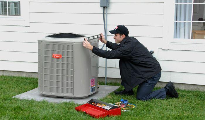 Technician installing Bryant Air Conditioner for Tradewinds HVAC of Denver Colorado!