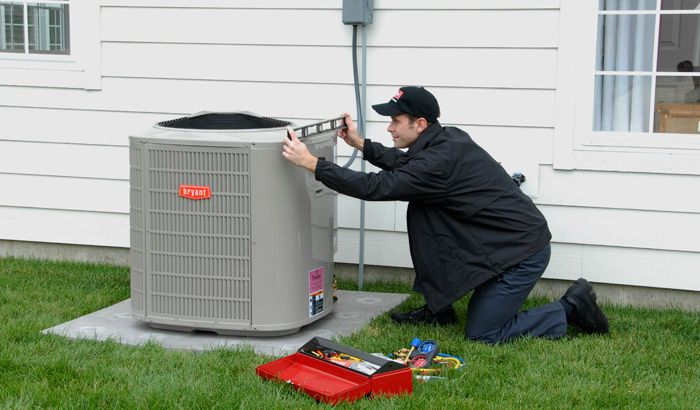 Technician installing Bryant Air Conditioner for Tradewinds HVAC of Denver Colorado!