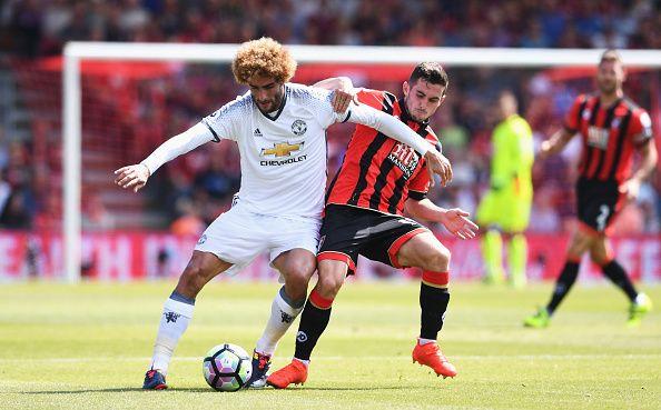 Marouane Fellaini Of Manchester United Is Challenged By Lewis Cook Of Afc Manchester United Manchester United Fans Manchester