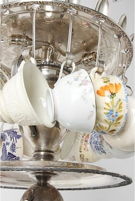 Vintage silver trays with spoon hooks to hold china cups.
