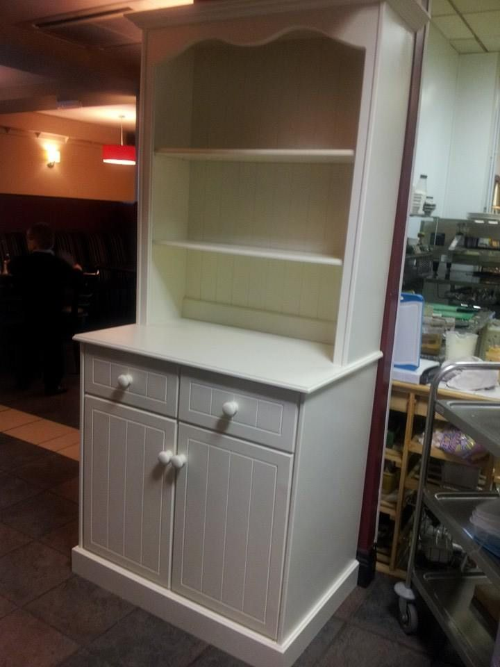 A Welsh dresser finished in a pale cream gloss