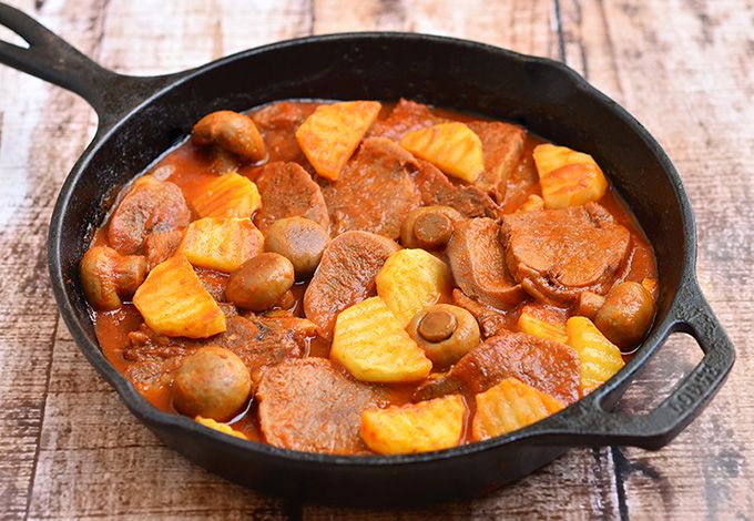 Lengua estofado is a Filipino dish made with tongue braised in tomato sauce