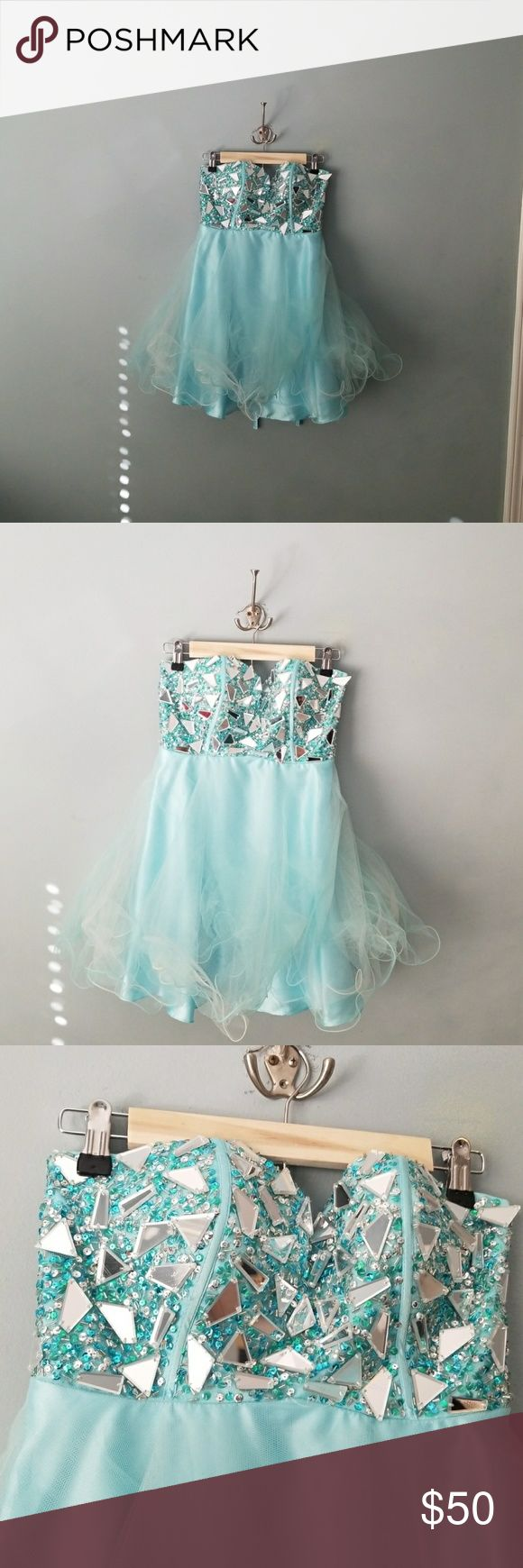 Homecoming dress Have your little princess look like a cupcake! This fun and flirty blue sparkling mini dress with all the frills will surely be a hit . May need to be dry cleaned has been in storage a while and looks like there may be some sunless tanner on the inside which you can't see when wearing price reflects Dresses