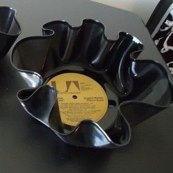 A thrifty recycled project is to make a vinyl record into a bowl. Its easy and simple to do. You can store anything in them like fruit, candy,...