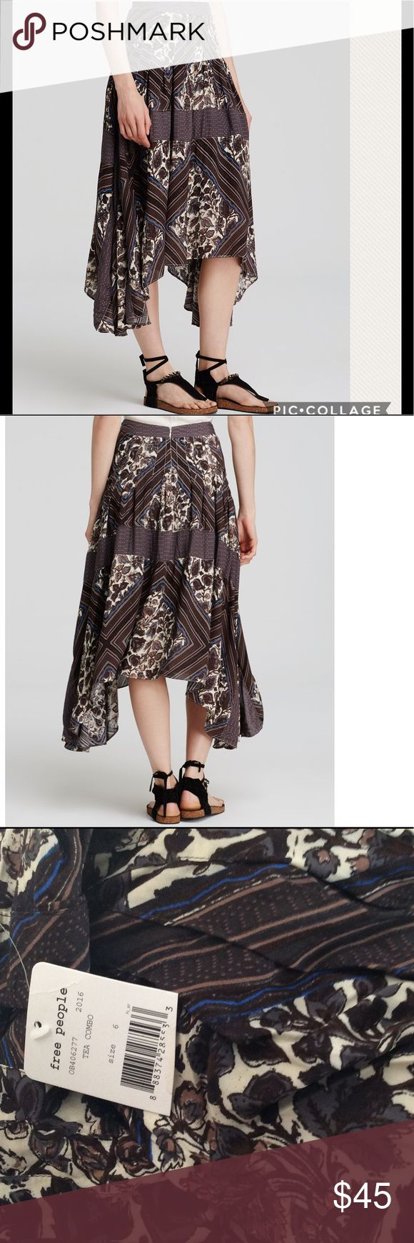 """NWT Free People Paradise Midi Skirt An eclectic mix of florals and stripes converge on this flirty-meets-free-spirited skirt from Free People. Banded waist, pleated, side slit pockets Concealed zip back closure, printed, asymmetric handkerchief hem Rayon. Unlined.  Machine wash. Waist 30"""" Free People Skirts Midi"""