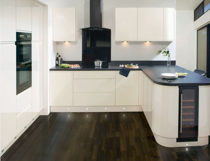 'The overall linear look is proving very popular in today's modern kitchen, and we will continue to see more plain and handleless doors for a simple yet modern style, predominantly in gloss finishes and in grey or neutral earthy hues.' - LochAnna Kitchens. Get more tips at housebeautiful.co.uk