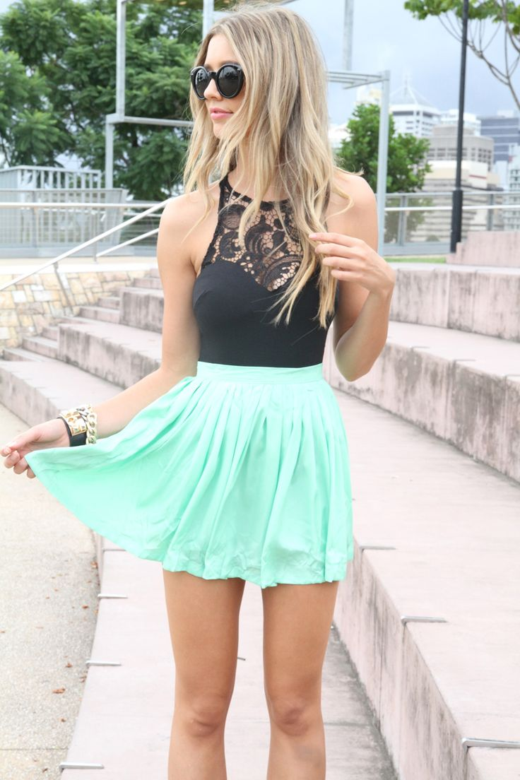 The mint skirt is a great way to mix up your all black attire