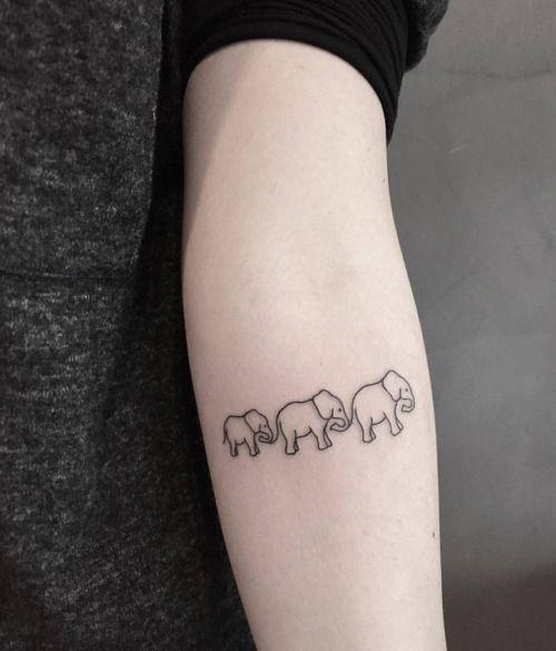 Elephant family on the left inner forearm. Tattoo Artist: Giulia...