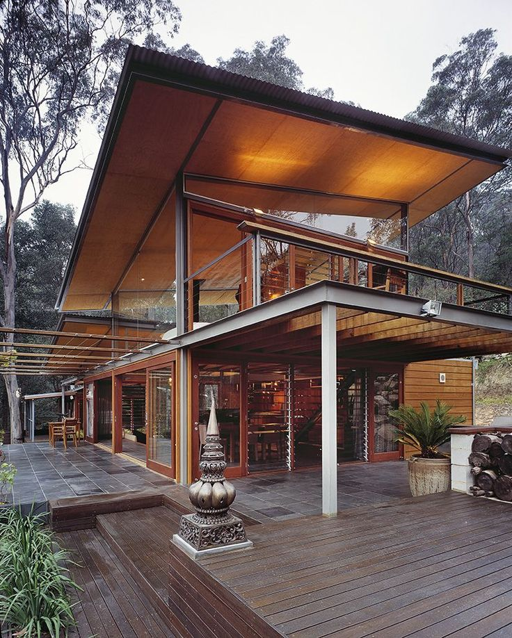 The Bowen Mountain House in Australia - composed of a steel frame, with the addition of new and recycled Australian hardwoods to finish the facade. Soft-toned grey steel was used for the dramatically angled roof, which blends with the muted tones of the surrounding bush.