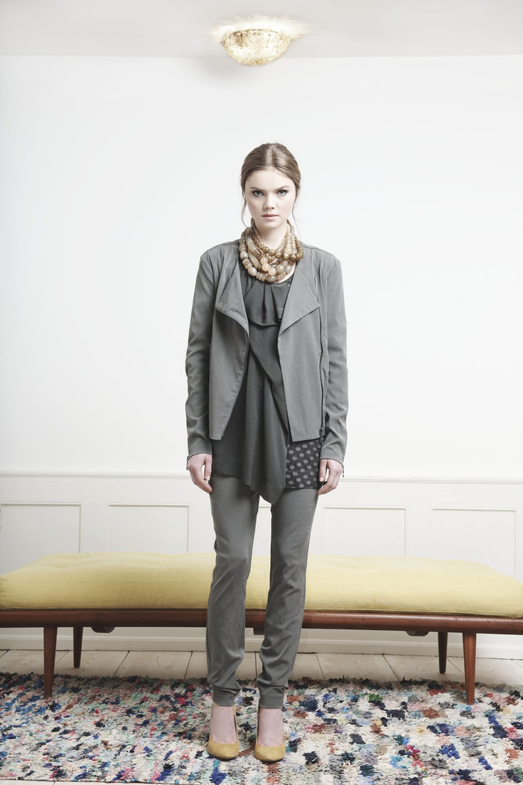 Rützou grey suede jacket with zippers.  Grey trousers and draped dotted tunic.