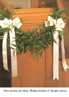 Here is a lovely and simple yet different option for the pews.  Might be nice in the same greens as the front church door wreaths.