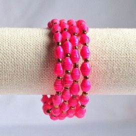 Ssanyu bracelet - pink  This wrap around bracelet was named Ssanyu,by the women, meaning Joy. It is also a name given to women. Hand rolled paper beads strung on metal cording, wrap happily around your wrist two or three times. No need for a fastener.