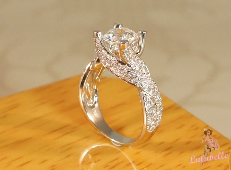 The Whirlwind Ring - White sapphire and Diamond pave setting 14k white gold engagement or wedding ring. $2,195.00, via Etsy. Yes please