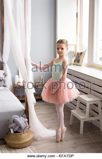 aa1cae6f9 Cute little ballerina in pink ballet costume and pointe shoes is dancing in  the room. Child girl is studying ballet. - Stock Image