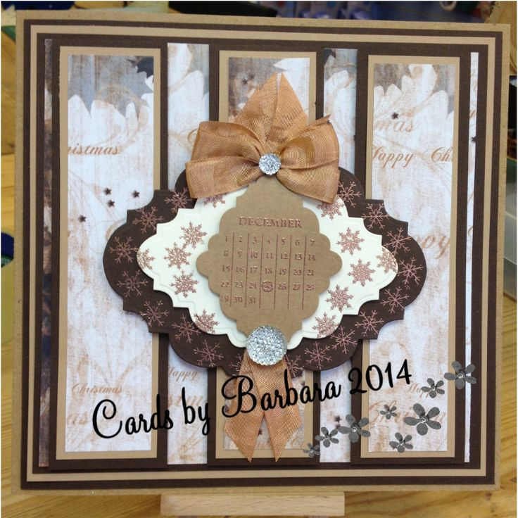 Made using craft card, with Christmas background papers, spellbinder die.The calender is from the Christmas Collection and the snowflake stamp from the Montage collection. To finish I used seam binding for the bow and topped with dazzlers