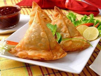 Indian Food :   Samosa is a fried or baked pastry with savory filling, such as spiced potatoes, onions, peas and lentils. Indian samosas are usually vegetarian, and often accompanied by a Mint sauce or chutney.