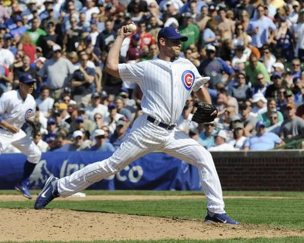 Kerry Wood of the Chicago Cubs strikes out the last batter he'll ever face during the Crosstown Classic against the Chicago White Sox on May 18 2012 at Wrigley Field in Chicago, Illinois. #MLB #Cubs #Baseball #ChicagoCubs    www.fansedge.com/Kerry-Wood-Chicago-Cubs-5182012-_1585427382_PD.html?social=pinterest_base_52212_wood1