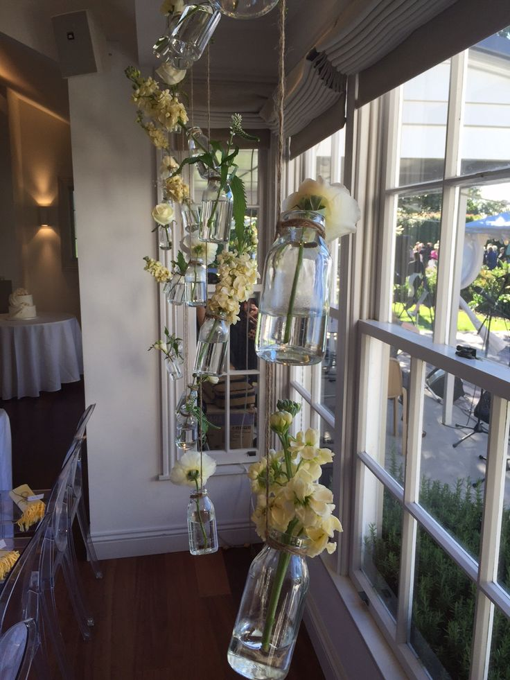 Flowers in Jars is a very popular choice behind the head table. And it looks amazing!