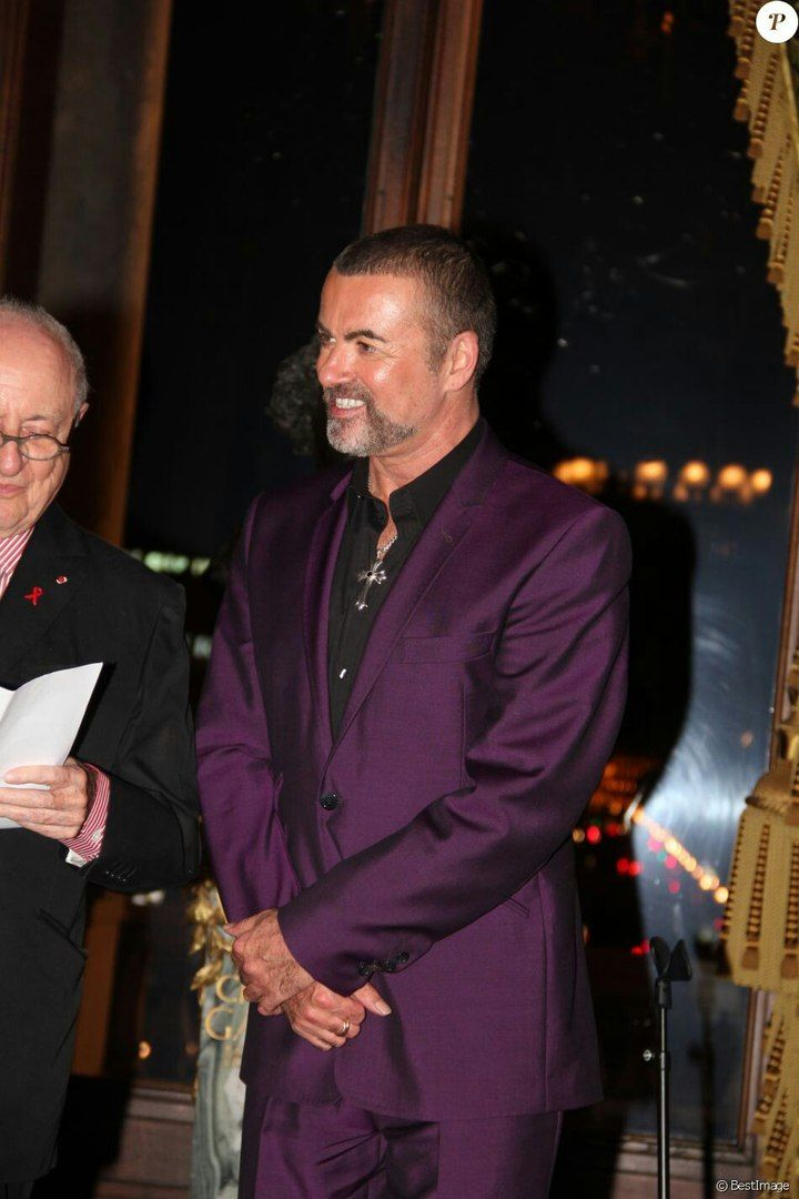 His favorite purple suit!!!