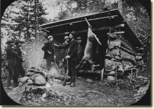 Camping Out - Adirondack Mountains. 1886. Hunters around a campfire at the Ausable Club. New York State Archives