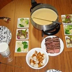 Best Formula Three-Cheese Fondue1 cup white wine Woodbridge Wine Chardonnay, California  $9.99 - Expires in 5 days  1 tablespoon butter 1 tablespoon all-purpose flour 7 ounces Gruyere cheese, cubed 7 ounces sharp Cheddar cheese, cubed 7 ounces Emmentaler cheese, cubed