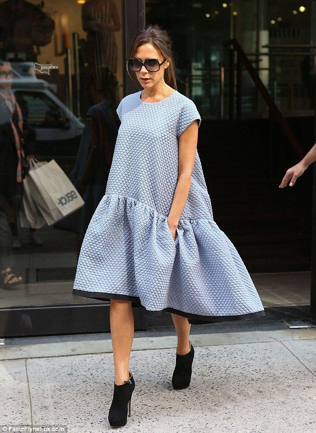 Victoria Beckham paired her ribbed dress from her SS14 collection with chic black bootie heels, a ponytail, and large sunglasses