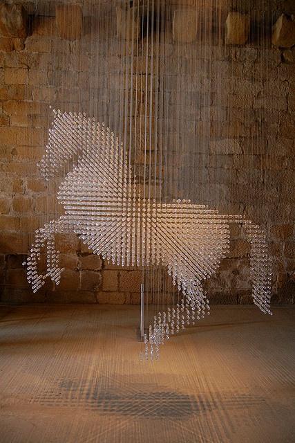 Amazing Stella McCartny horse sculpture using 10,000 swarovski crystals suspended in midair