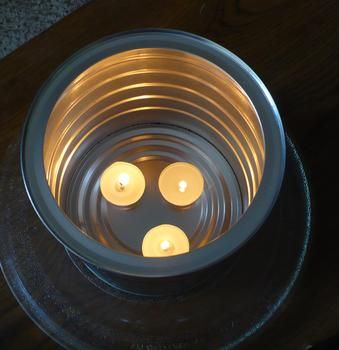 Link to an article explaining how to use a metal coffee can and tea lights to heat a space.