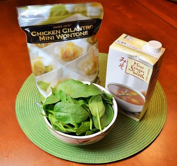 Easy 10 minute Wonton soup, Trader  joes, miso stock, pkg wontons, greens.