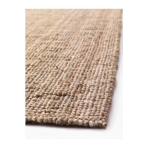 jute rugs are a better choice  space where you are going to be sitting or laying down on the floor- they are quite knobby in texture and not scratchy like sisal and seagrass.  Because of their neutral colour variations they hide stains easily and are quite hard wearing with family usage