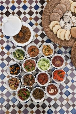 Selection of fine moroccan salads and tajine of lentils with khlie at Restaurant Le Marocain of Hotel La Mamounia in Marrakech