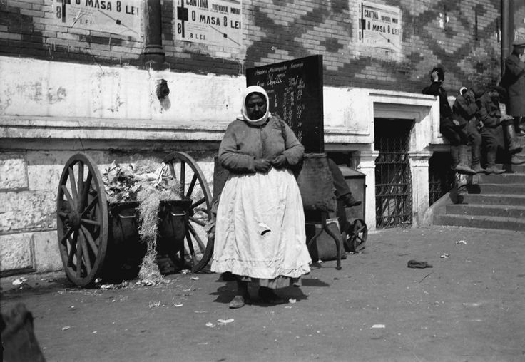 Gypsy woman at the garbage can, April 1932