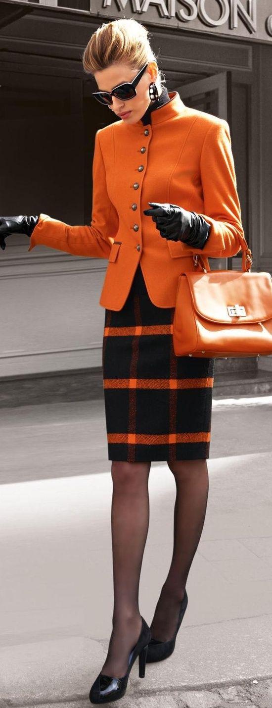 orange military cut blazer. Black pencil skirt with orange stripes