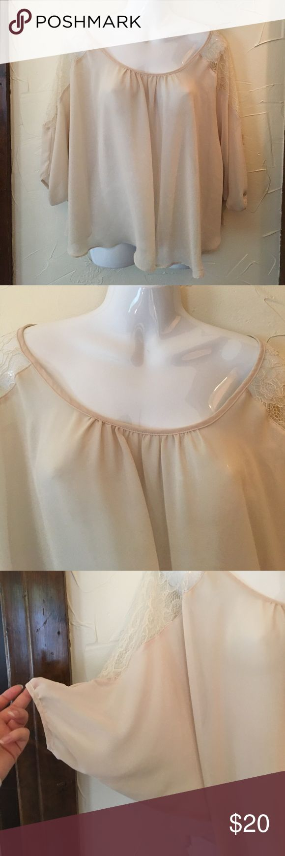 LC Lauren Conrad Sheer Batwing Blouse Cream colored Sheer batwing Blouse from LC Lauren Conrad. Size XS. Is see through. Has Lace on the shoulders. Is lightweight. In good condition. LC Lauren Conrad Tops Blouses