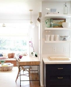Kitchen Desk Ideas. Two-toned kitchen opens to a small area filled with a desk. Shea McGee Design.
