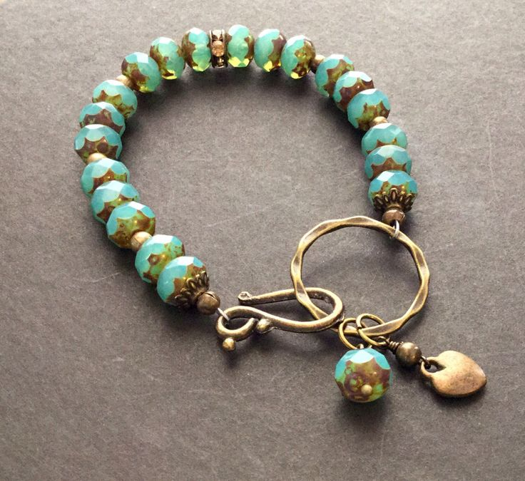 Aqua Picasso Czech Glass Beaded Bracelet by ReinaRiosDesigns on Etsy https://www.etsy.com/listing/237714436/aqua-picasso-czech-glass-beaded-bracelet