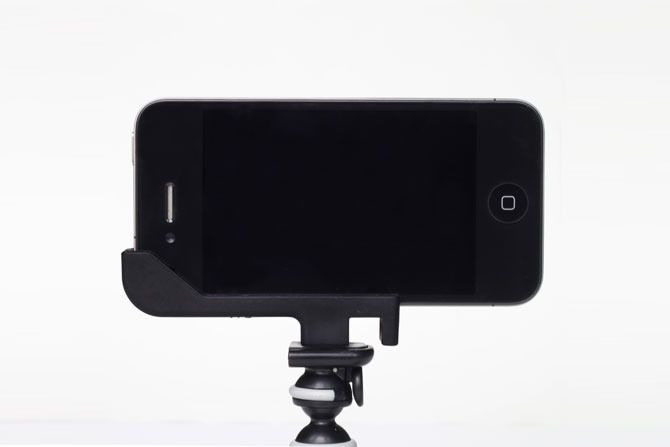 The Glif is an iPhone 4/4S accessory with two primary functions: mounting your iPhone onto a tripod and propping up your iPhone at various angles. Our goal was to create something small, simple, and elegant. But out of this simple design emerges countless uses. Mount your iPhone to a tripod for taking great pictures or making movies. Prop your iPhone up for hands-­free FaceTiming or to watch videos. All of that and more in a compact design that is manufactured in America.