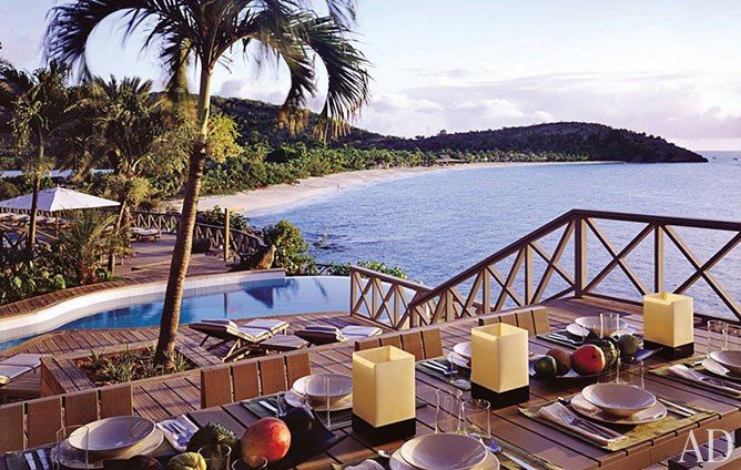 Dining alfresco at Armani's Antigua home.