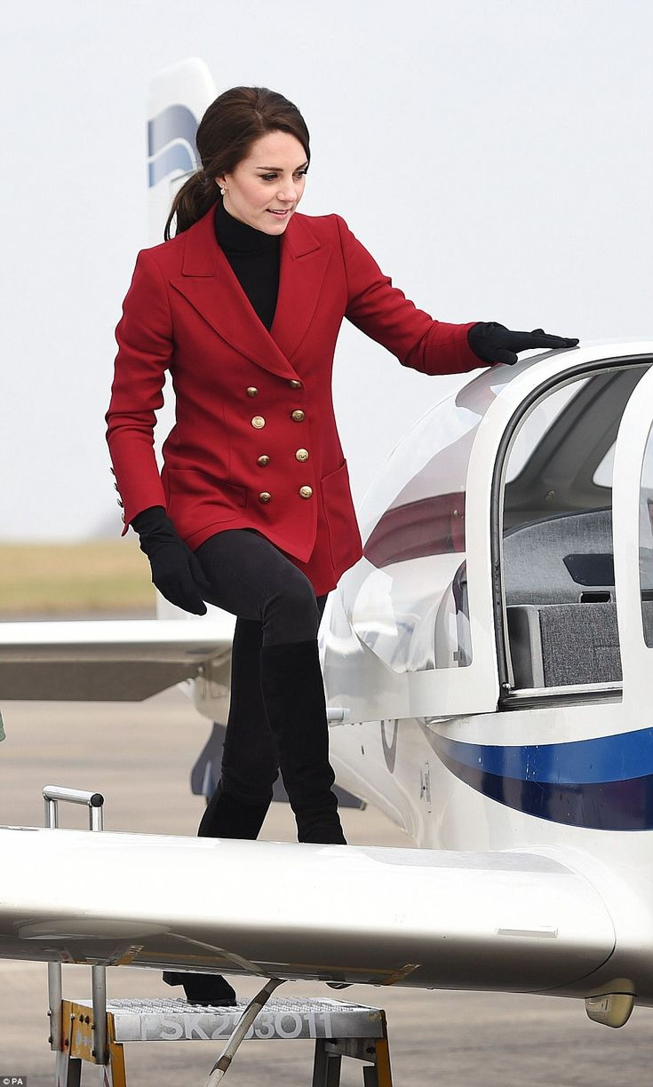The Duchess of Cambridge, royal patron and Honorary Air Commandant of the RAF Air Cadets climbing into a training aircraft