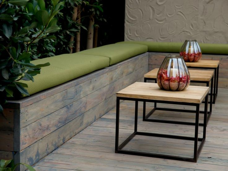 Simply Styled Outdoor Wooden Benches Together With Three Metal And Wood  Cube Tables Create A Good