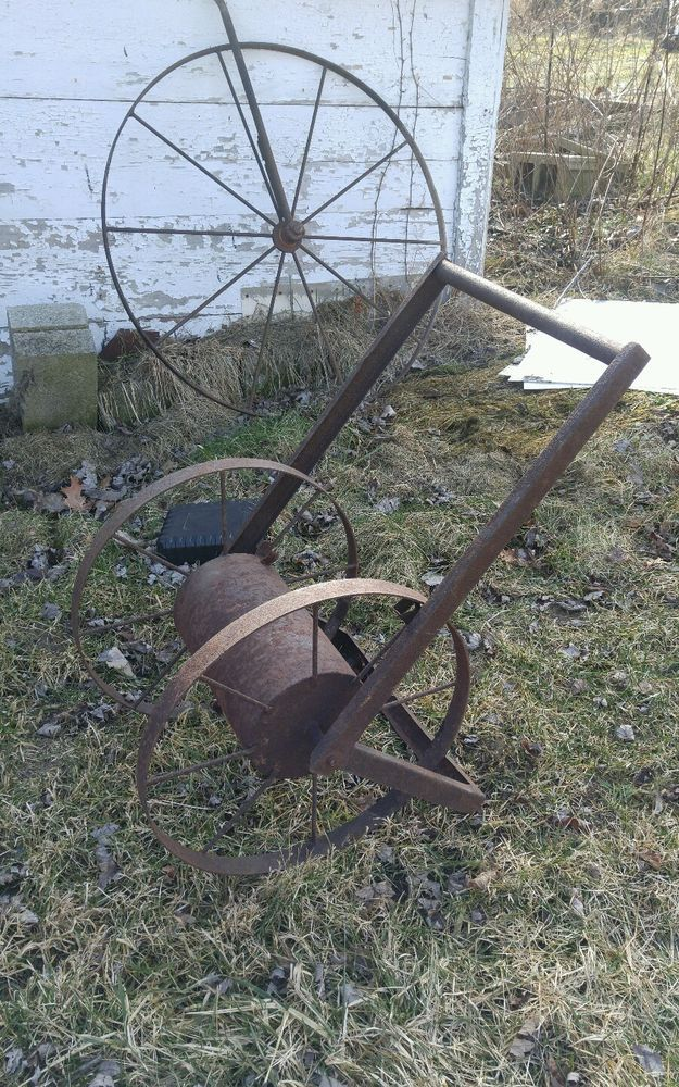 Rustic garden hose reel cast metal farm wheels large reel decor Industrial vtg
