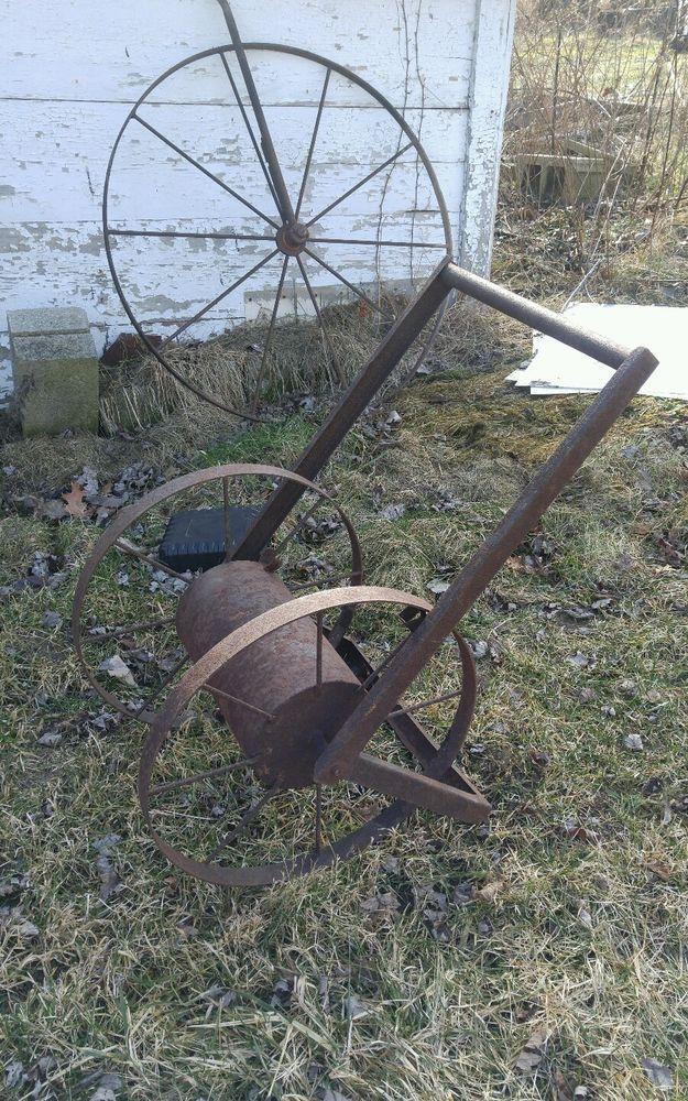 Rustic garden hose reel cast metal farm wheels large reel decor Industrial vtg