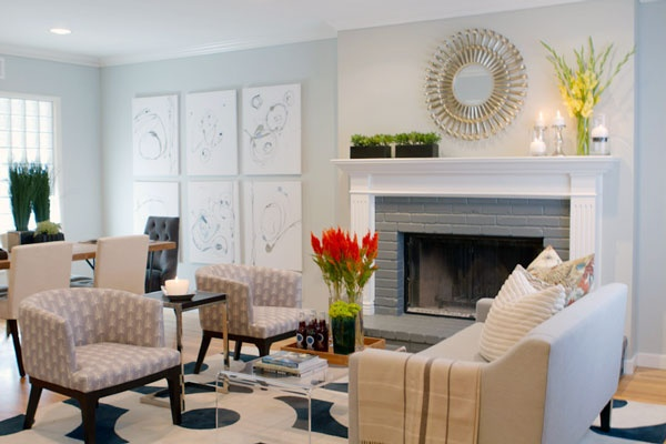 Living room with painted brick fireplace, and West Elm furniture/accessories.