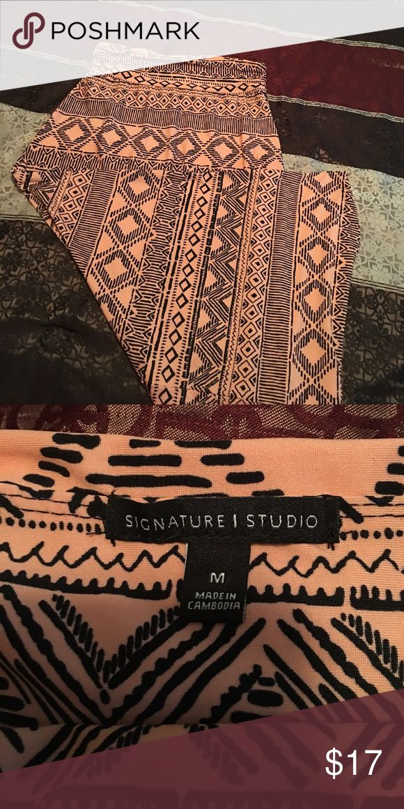 Adorable Aztec style Maxi skirt Never worn. Salmon and Black maxi skirt, super soft! Signature Studio Skirts
